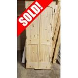 #Z050 2/8 DBL 2-Panel Arch Knotty Pine